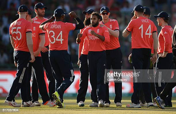 Adil Rashid of England celebrates with teammates after dismissing Noor Ali Zadran of Afghanistan during the ICC World Twenty20 India 2016 Group 1...
