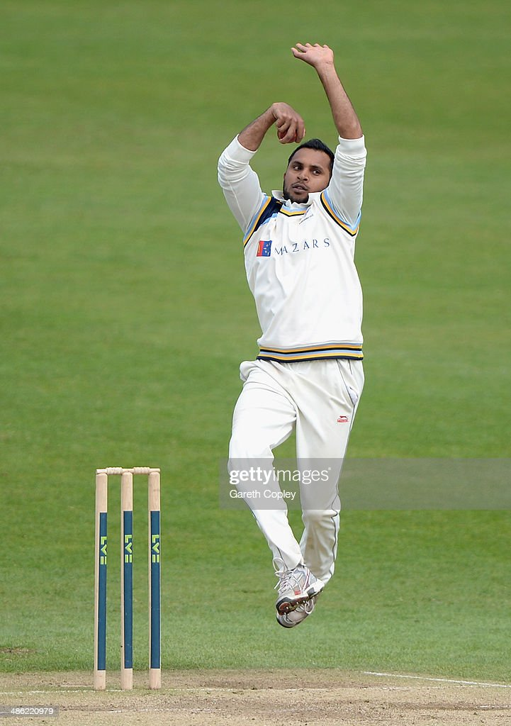 Adil Rashid of Yorkshire bowls during day four of the LV County Championship division One match between Yorkshire and Northamptonshire at Headingley on April 23, 2014 in Leeds, England.