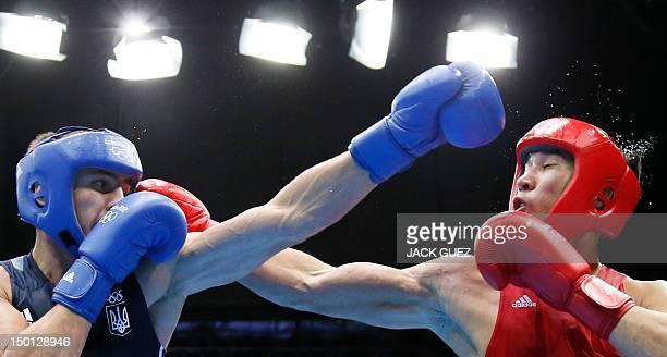 Adilbek Niyazymbetov of Kazakhstan defends against Oleksandr Gvozdyk of the Ukraine during the men's Light Heavyweight boxing semifinals of the 2012...