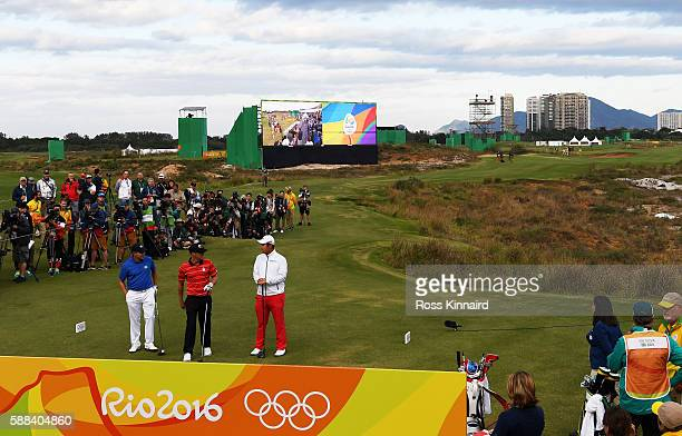 Adilson da Silva of Brazil Graham Delaet of Canada and Byeong Hun An of Korea prepare to play from the first tee during the first round of men's golf...
