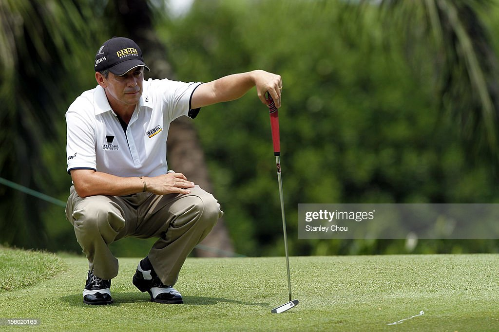 Adilson Da Silva of Brazil lines for a putt on the 3rd hole during the fourth round of the Barclays Singapore Open at the Sentosa Golf Club on November 11, 2012 in Singapore.