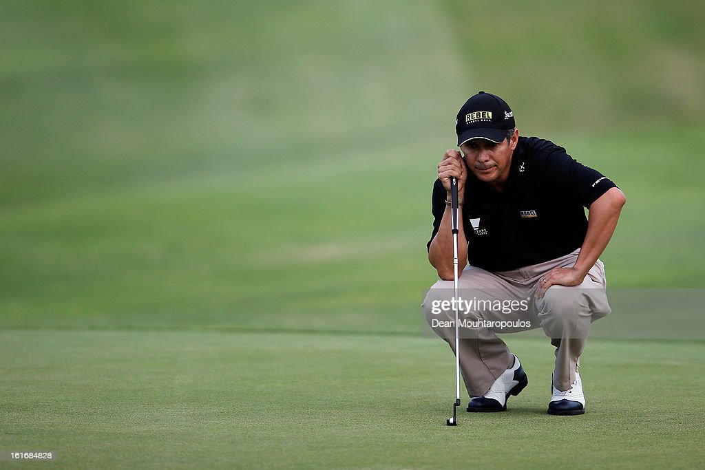 Adilson da Silva of Brazil lines up his putt on the 7th green during Day One of the Africa Open at East London Golf Club on February 14, 2013 in East London, South Africa.