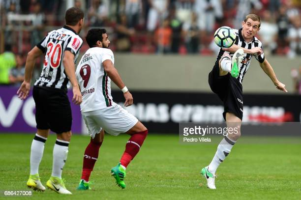 Adilson of Atletico MG and Henrique Dourado of Fluminense battle for the ball during a match between Atletico MG and Fluminense as part of...