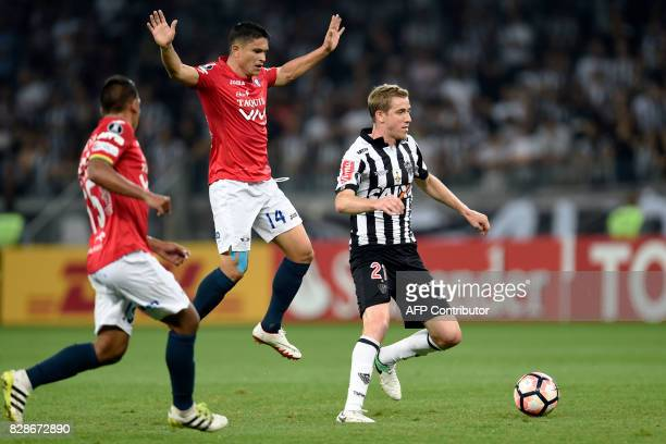 Adilson of Brazil's Atletico Mineiro vies for the ball with Jorge Antonio Ortiz of Bolivia's Jorge Wilstermann during their 2017 Copa Libertadores...