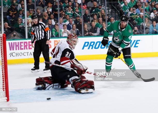 Adin Hill of the Arizona Coyotes kicks aside a shot against Alexander Radulov of the Dallas Stars at the American Airlines Center on October 17 2017...