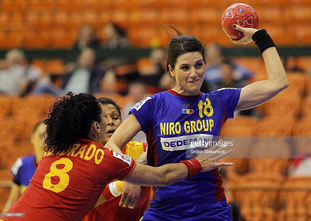 Adina Laura Meirosu of Romania (R) shoot the ball past Veronica Cuadrado Dehesa of Spain (L) during the Women's European Handball Championship 2012 Group II main round match between Spain and Romania at Spens Hall on December 9, 2012 in Novi Sad, Serbia.