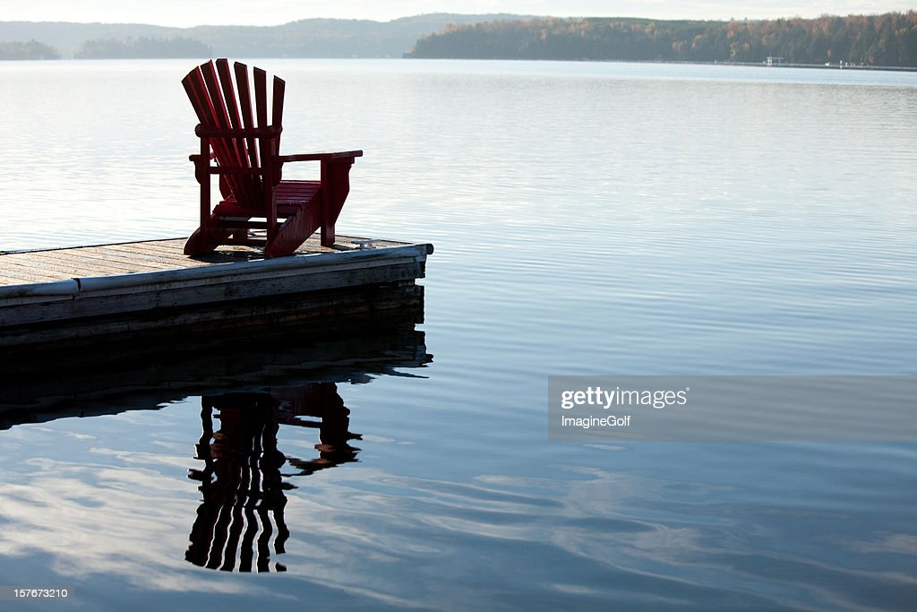 Adirondack Chair By A Lake
