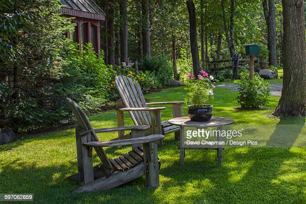 Adirondack chairs and flower pot