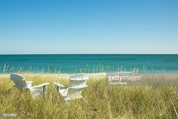 Adirondack Chairs in dunes at beach