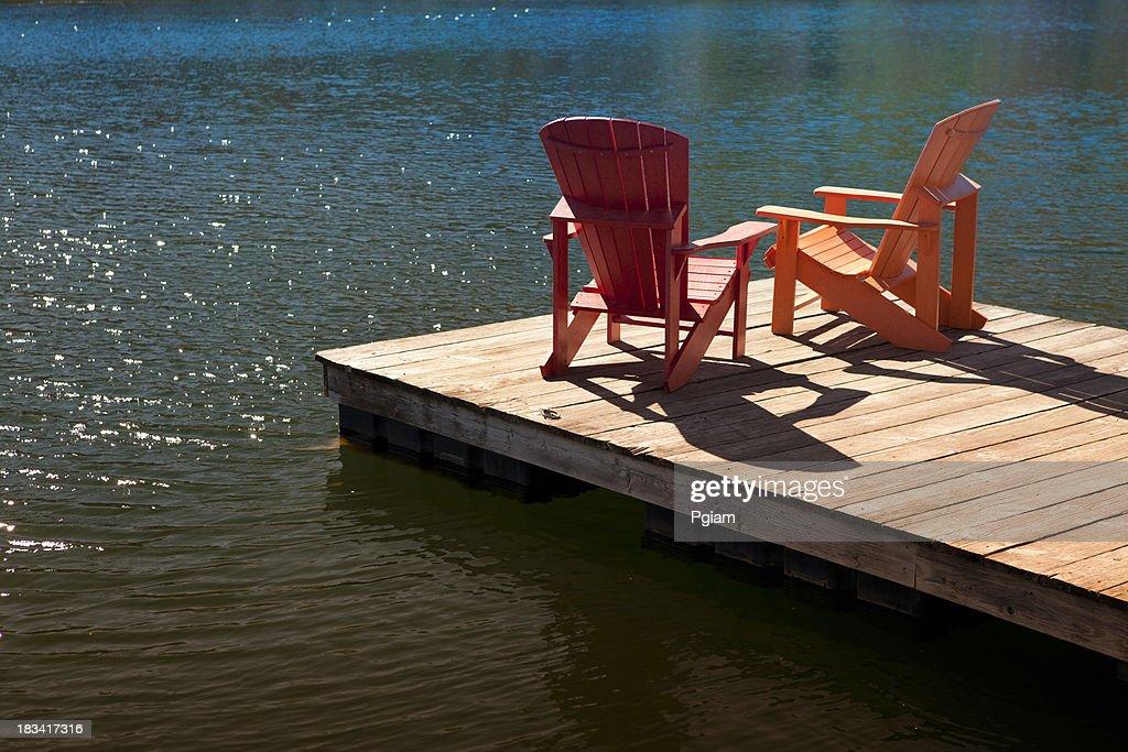 Adirondack chairs on a dock