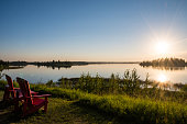 Red chairs offer pretty view of Astotin Lake in late summer.