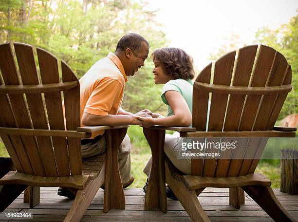 Adirondack Couple Sitting Face to Face