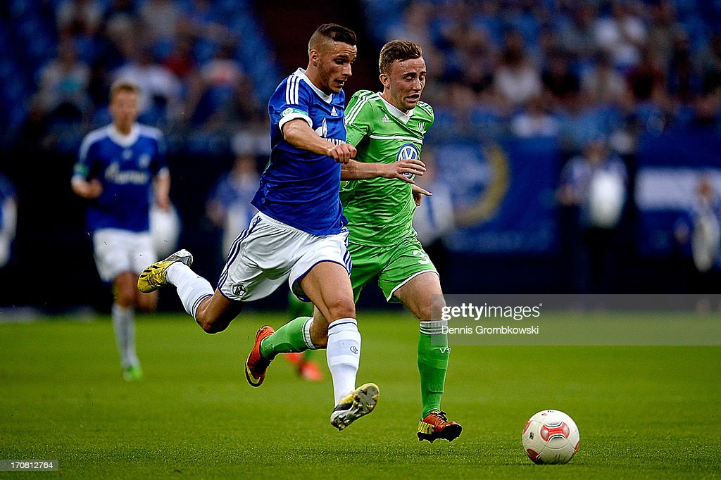 Adis Omerbasic of Schalke is chased by Marvin Kleihs of Wolfsburg during the A Juniors Championships semifinal second leg match between Schalke 04 and VfL Wolfsburg at Veltins-Arena on June 18, 2013 in Gelsenkirchen, Germany.
