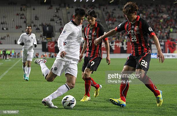 Adisak Kraisorn of Buriram United in action with Kim NamChun and Kim ChiWoo of FC Seoul during the AFC Champions League Group E match between FC...