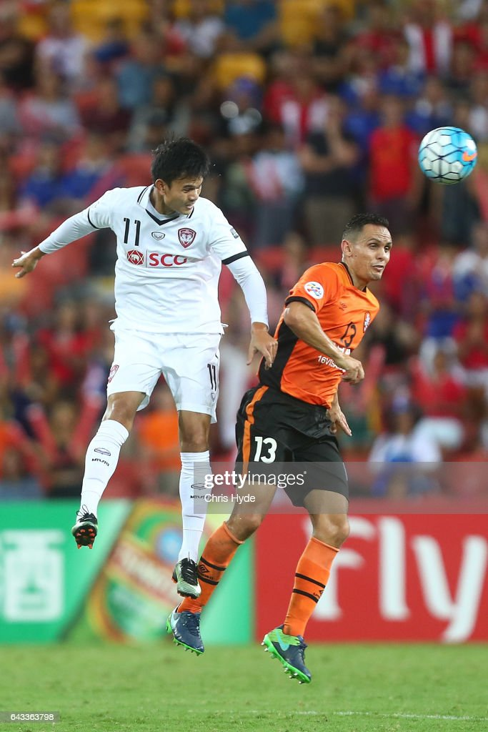 Adisak Kraisorn of Muangthong United and Jade North of the Roar compete for the ball during the AFC Champions League match between the Brisbane Roar and Muangthong United at Suncorp Stadium on February 21, 2017 in Brisbane, Australia.