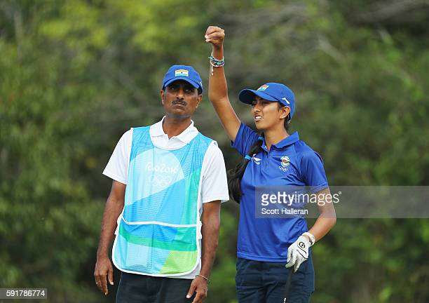 Aditi Ashok of India chats with her father/caddie Pandit Gudlamani during the second round of the Women's Individual Stroke Play golf on Day 13 of...