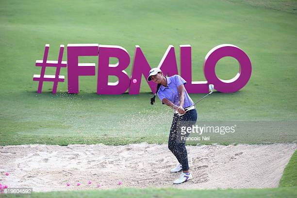 Aditi Ashok of India plays a shot from a bunker on the 17th hole ahead of the Fatima Bint Mubarak Ladies Open at Saadiyat Beach Golf Club on October...