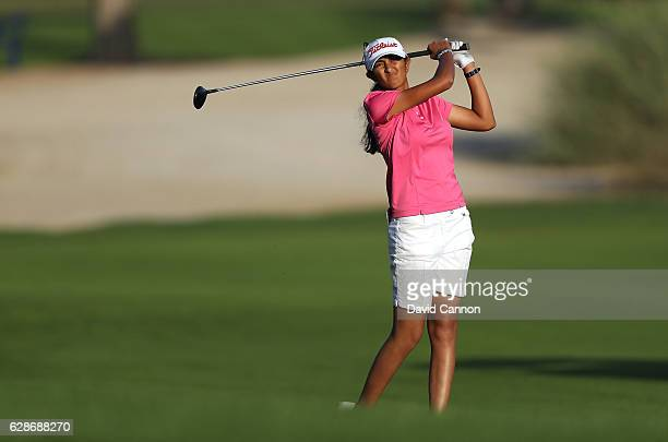 Aditi Ashok of India plays her second shot on the 10th hole during the delayed second round of the 2016 Omega Dubai Ladies Masters on the Majlis...