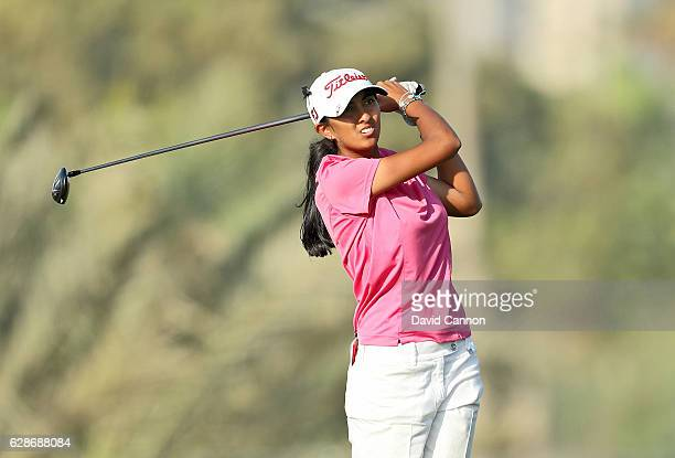 Aditi Ashok of India plays her second shot on the 13th hole during the delayed second round of the 2016 Omega Dubai Ladies Masters on the Majlis...