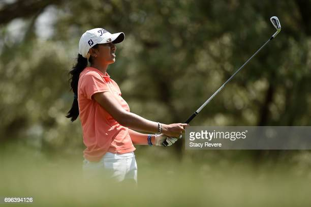 Aditi Ashok of India watches her tee shot on the 12th hole during the first round of the Meijer LPGA Classic at Blythefield Country Club on June 15...