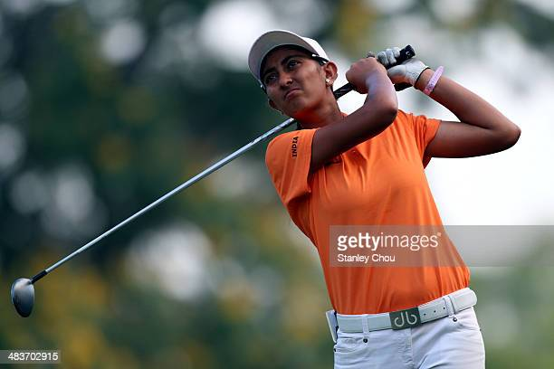 Aditi Ashok of India watches her tee shot on the 4th hole during day two stroke play of the Queen Sirikit Cup of Golf at the Saujana Golf and Country...