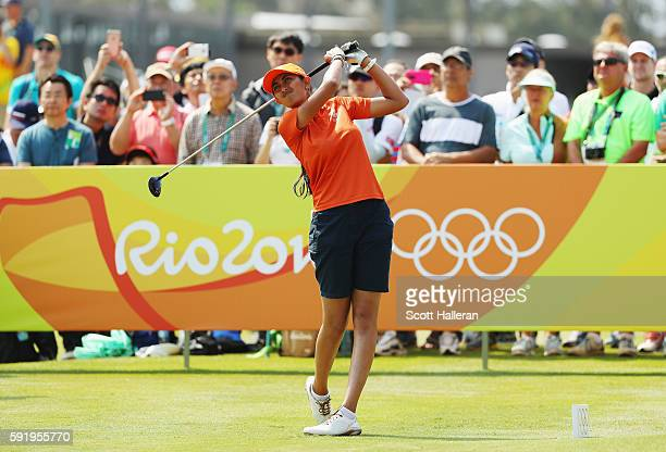Aditi Ashok of India watches her tee shot on the first hole during the third round of the Women's Individual Stroke Play golf on Day 14 of the Rio...