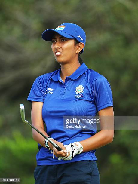Aditi Ashok of India watches her tee shot on the fourth hole during the second round of the Women's Individual Stroke Play golf on Day 13 of the Rio...