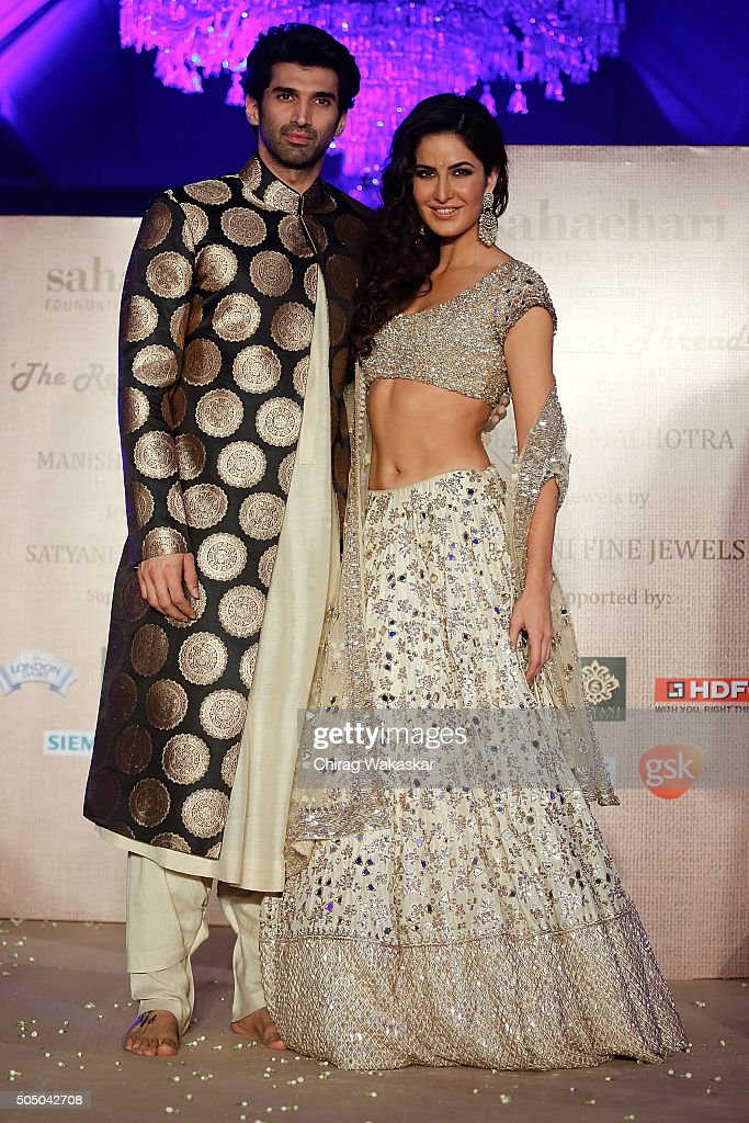 Aditya Roy Kapur and Katrina Kaif walk the runway at Regal Threads Fashion Show By Manish Malhotra at Trident Hotel on January 14 2016 in Mumbai India
