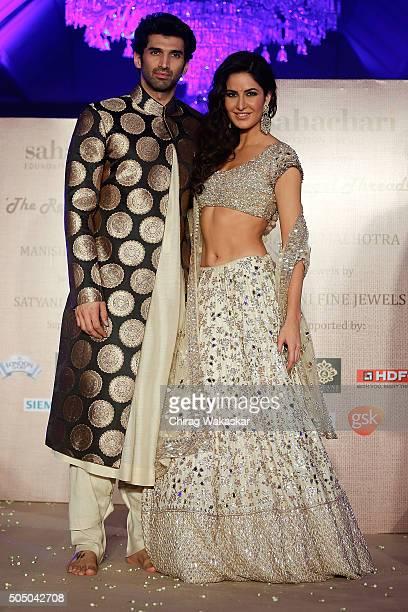 Aditya Roy Kapur and Katrina Kaif walk the runway at Regal Threads Fashion Show By Manish Malhotra at Trident Hotel on January 14 2016 in Mumbai India
