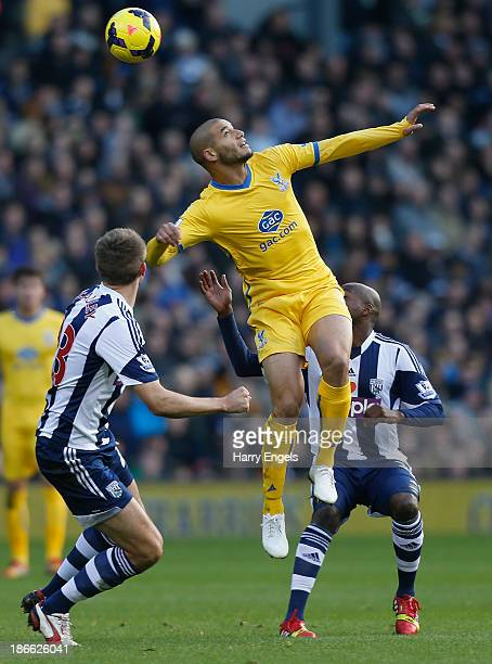 Adlene Guedioura of Crystal Palace wins a header during the Barclays Premier League match between West Bromwich Albion and Crystal Palace at The...