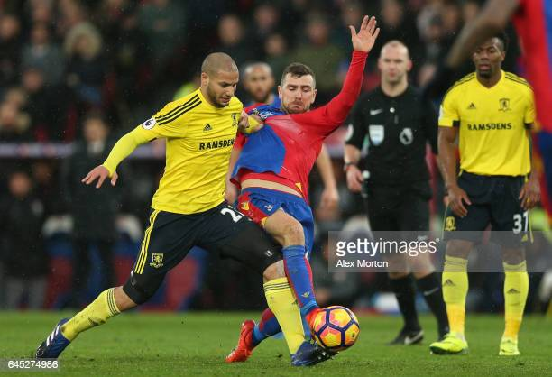 Adlene Guedioura of Middlesbrough and Damien Delaney of Crystal Palace battle for possession during the Premier League match between Crystal Palace...
