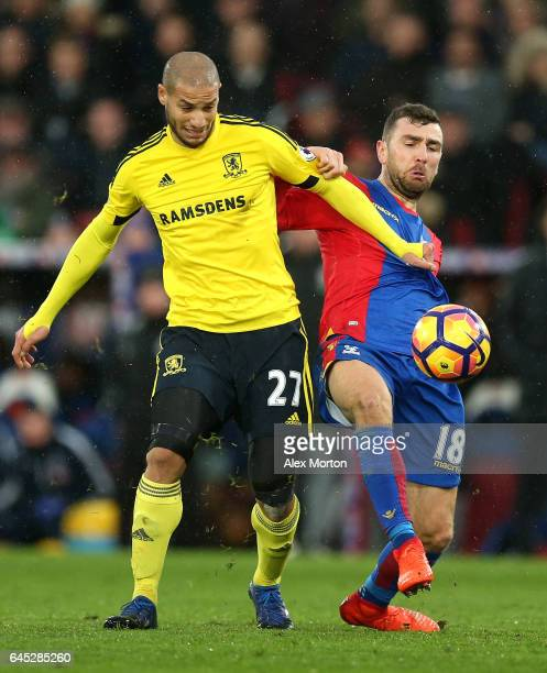 Adlene Guedioura of Middlesbrough and James McArthur of Crystal Palace battle for possession during the Premier League match between Crystal Palace...