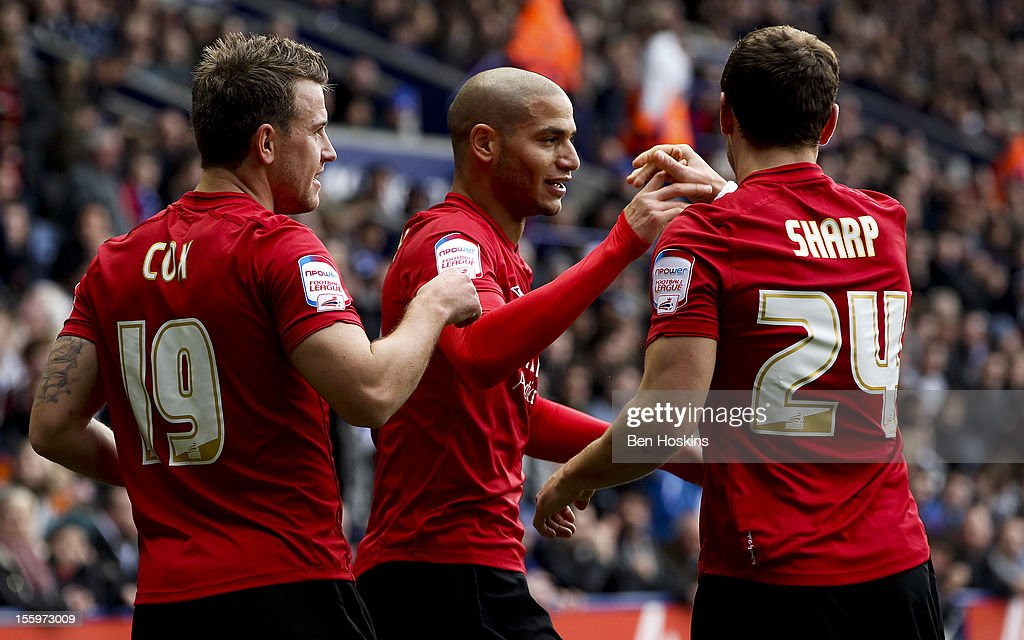 <a gi-track='captionPersonalityLinkClicked' href=/galleries/search?phrase=Adlene+Guedioura&family=editorial&specificpeople=6732967 ng-click='$event.stopPropagation()'>Adlene Guedioura</a> of Nottingham celebrates with team mates after scoring his team's first goal during the npower Championship match between Leicester City and Nottingham Forest at the King Power Stadium on November 10, 2012 in Leicester, England.