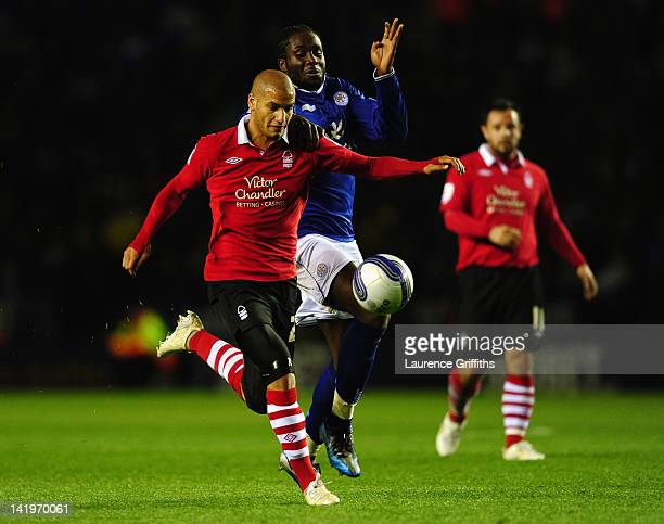 Adlene Guedioura of Nottingham Forest battles with Sol Bamba of Leicester City during the npower championship match between Leicester City and...