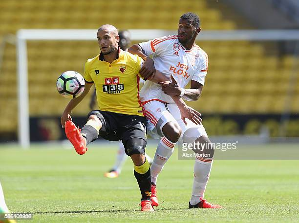Adlene Guedioura of Watford and Carlos Miguel Cafu of Lorient during the preseason friendly match between Watford and Lorient at Vicarage Road on...