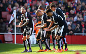 Adlene Guedioura of Watford celebrates with team mates as he scores their second goal during the Emirates FA Cup sixth round match between Arsenal...