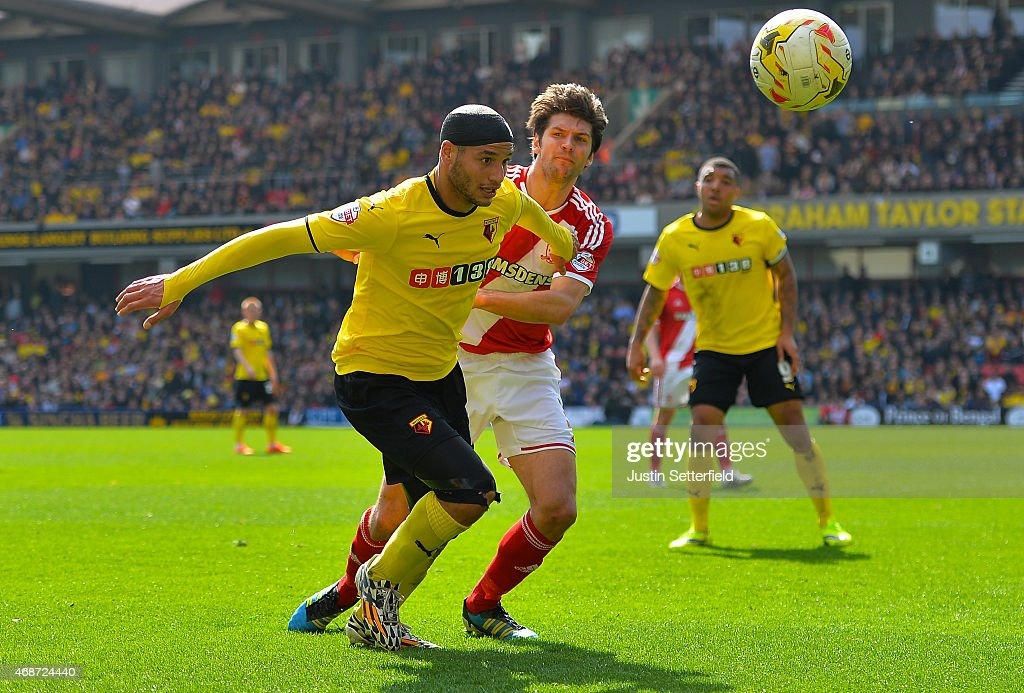 <a gi-track='captionPersonalityLinkClicked' href=/galleries/search?phrase=Adlene+Guedioura&family=editorial&specificpeople=6732967 ng-click='$event.stopPropagation()'>Adlene Guedioura</a> of Watford FC holds off George Friend of Middlesbrough FC during the Sky Bet Championship match between Watford and Middlesbrough at Vicarage Road on April 6, 2015 in Watford, England.