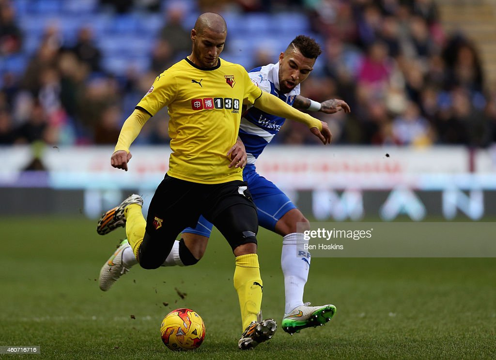 <a gi-track='captionPersonalityLinkClicked' href=/galleries/search?phrase=Adlene+Guedioura&family=editorial&specificpeople=6732967 ng-click='$event.stopPropagation()'>Adlene Guedioura</a> of Watford holds off the challenge of <a gi-track='captionPersonalityLinkClicked' href=/galleries/search?phrase=Danny+Williams+-+Soccer+Player&family=editorial&specificpeople=210944 ng-click='$event.stopPropagation()'>Danny Williams</a> of Reading during the Sky Bet Championship match between Reading and Watford at Madejski Stadium on December 20, 2014 in Reading, England.
