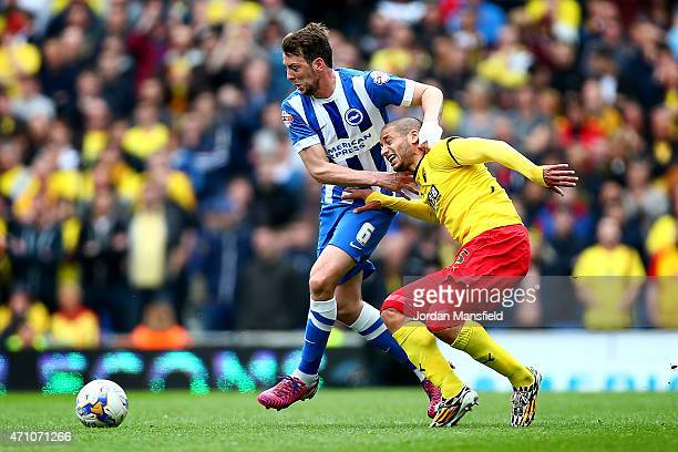 Adlene Guedioura of Watford is taken down by Dale Stephens of Brighton during the Sky Bet Championship match between Brighton Hove Albion and Watford...