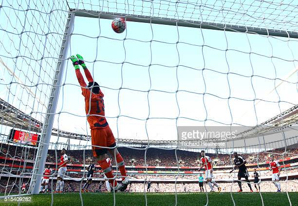 Adlene Guedioura of Watford scores the second goal past David Ospina of Arsenal during The Emirates FA Cup Sixth Round match between Arsenal and...