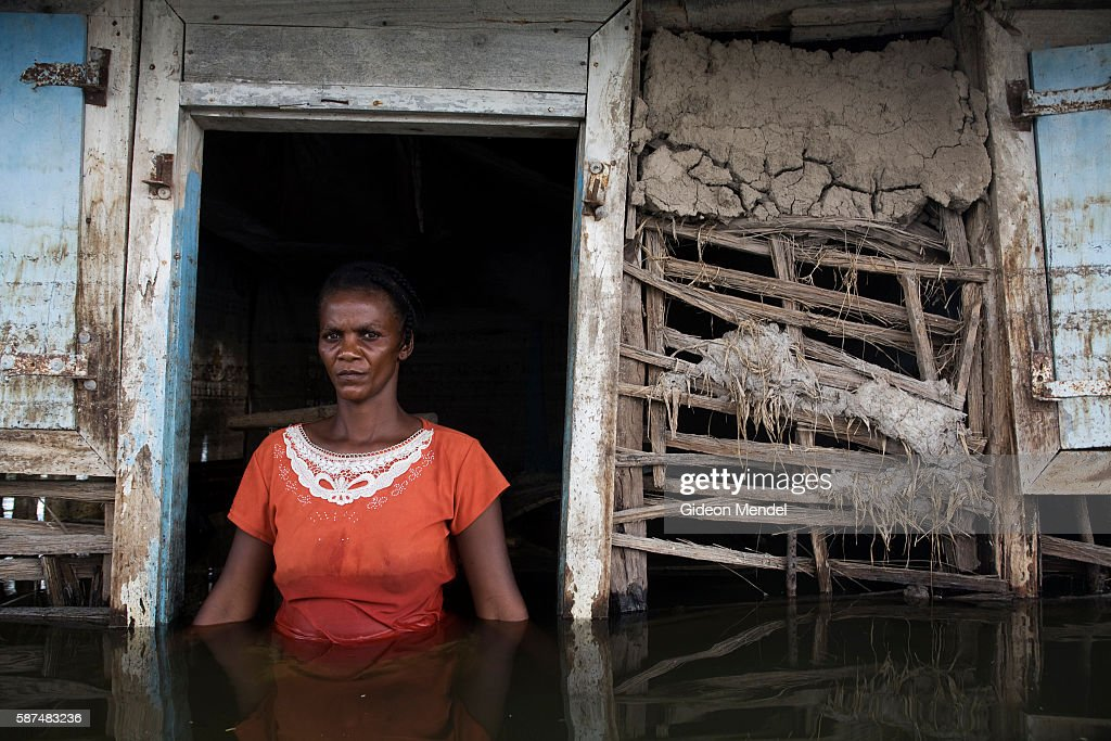 Adlene Pierre aged 35 faces the camera in the doorway of her flooded house in Savanne Desole on the outskirts of the city of Gonaives She had lost...
