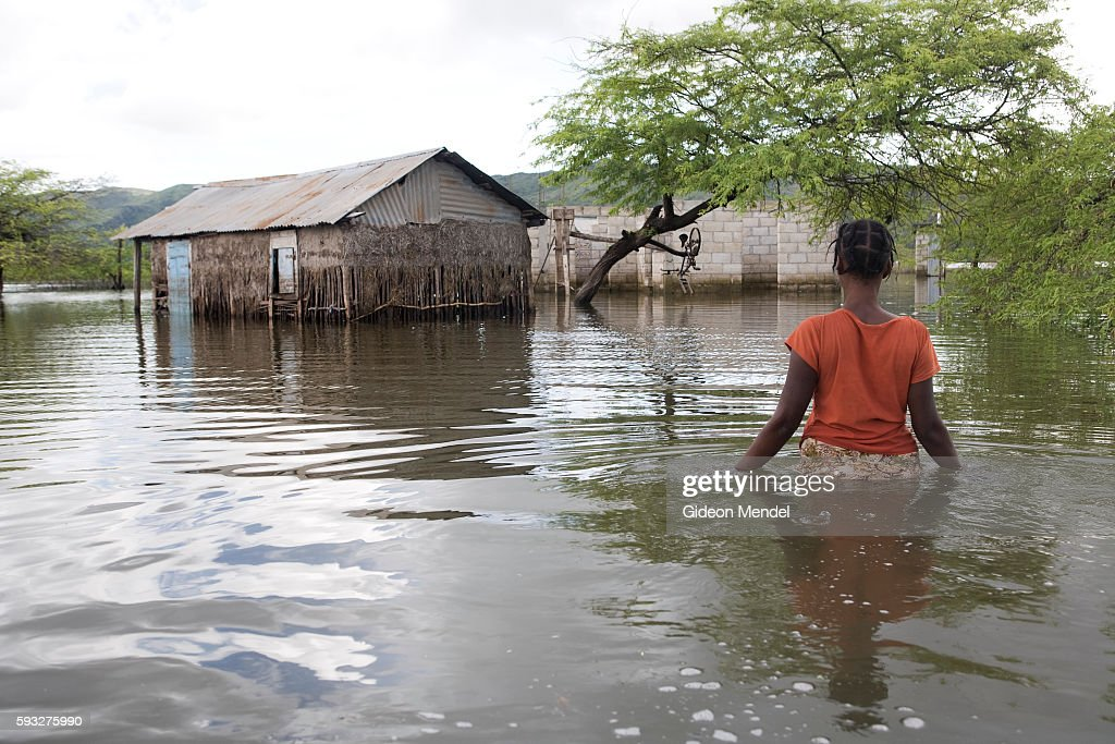 Adlene Pierre aged 35 walks towards her flooded house in Savanne Desole on the outskirts of the city of Gonaives She had lost most of her possessions...