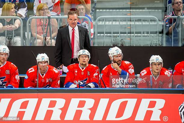 Adler Trainer Sean Simpson watches from the bench during the Champions Hockey League match between Adler Mannheim and HC Lugano at SAP on August 18...