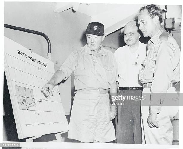 Adm B Hall Hanlon points out Nami Island on a map of Eniwetok Atoll during a briefing session for newsmen and official observers on the admiral's...