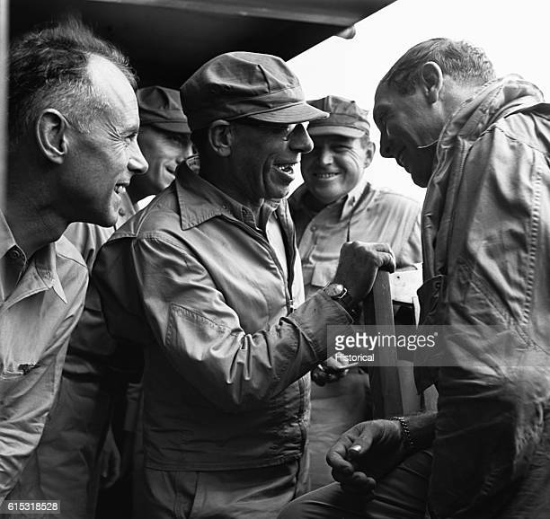 Adm Sherman center and Commander Clifton share a laugh as Clifton reports on a raid over Rabaul