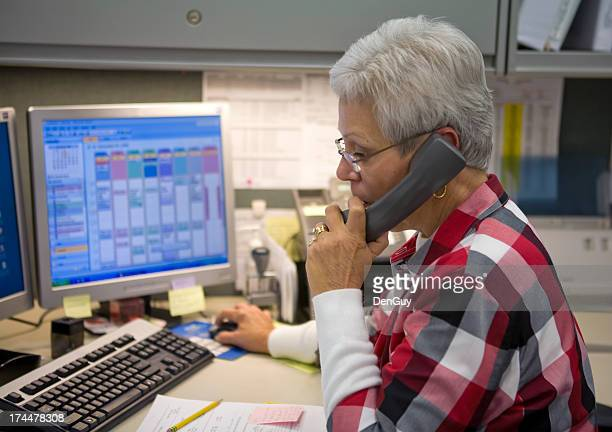 Administrative Specialist on Phone in Front of Computer