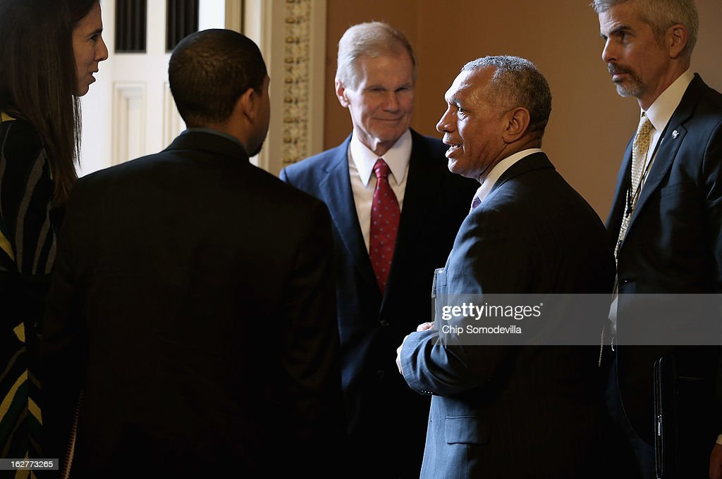 Administrator and former astronaut <a gi-track='captionPersonalityLinkClicked' href=/galleries/search?phrase=Charles+Bolden+-+NASA+Administrator&family=editorial&specificpeople=15164541 ng-click='$event.stopPropagation()'>Charles Bolden</a> (2nd R) talks with Sen. Bill Nelson (D-FL), also a former astronaut, in the halls of the U.S. Capitol February 26, 2013 in Washington, DC. With the threat of sequestration looming, the Senate Republicans and Democrats held their weekly policy luncheons.