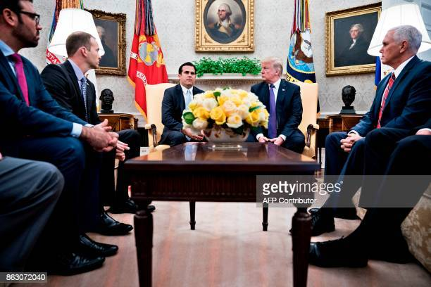 Administrator Brock Long Governor of Puerto Rico Ricardo Rossello US President Donald Trump and US Vice President Mike Pence wait with other for a...