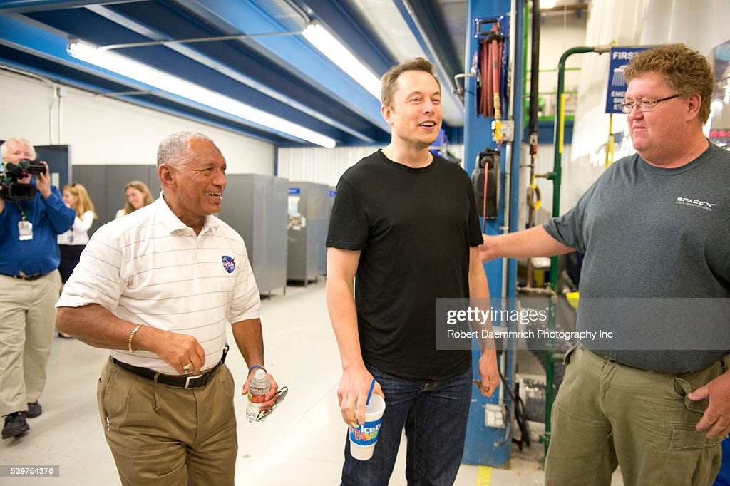 NASA administrator Charles Bolden left and SpaceX CEO and Chief Designer Elon Musk enter a press conference about the private Dragon spacecraft that...
