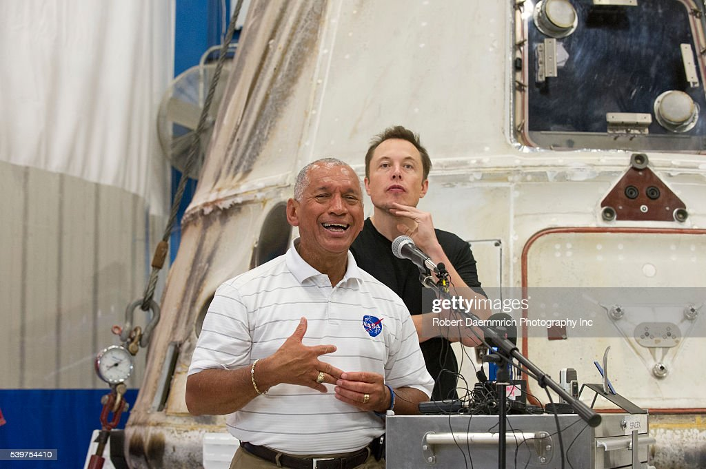 NASA administrator Charles Bolden left and SpaceX CEO and Chief Designer Elon Musk right answer questions about the private Dragon spacecraft that...
